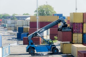 A truck picks up a container for import and export business