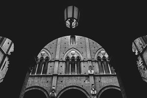 Arches at Palazzo Pubblico in Siena, Italy