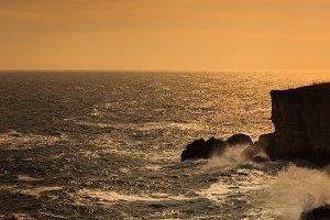 Magical sunset over stone coast