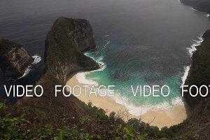 Rocky cliff with beach in the sea. Karang Dawa.