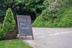 Signpost joke saying Free beer tomorrow