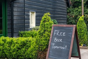 Signpost joke saying Free beer tomorrow