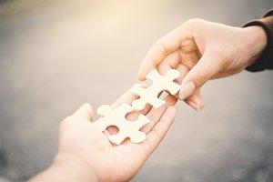 hand holding jigsaw