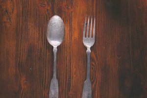 Spoon and fork on wood