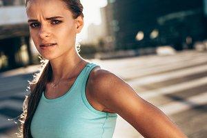 Sportswoman standing outdoors