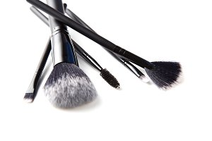 Selection of makeup brushes isolated on white.