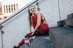 Fitness woman taking break