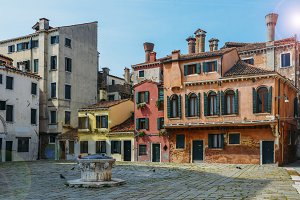 Colourful and historic houses at the Campo della Maddalena in Venice, Italy, with a variety of shapes and sizes in the local architecturural style.