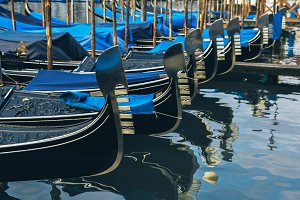 Rows of gondolas on a canal in Venice, Italy