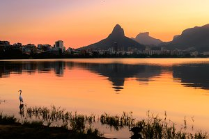 Beautiful View of Rio de Janeiro Sunset Behind Mountains at Rodrigo de Freitas Lake.