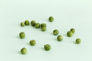 Peas on green background