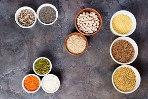 Superfoods and cereals selection in bowls on stone background