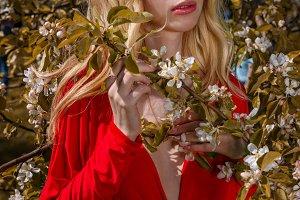Beautiful young woman in garden