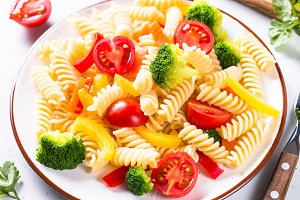 Vegan pasta fusilli with vegetables.