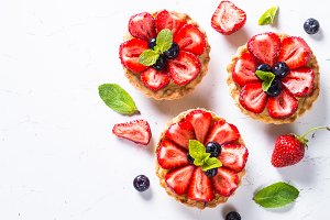 Strawberry tart on white.
