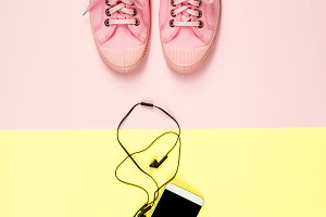 Pink canvas sneakers and mobile phone