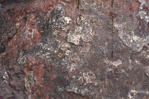 Texture of mottled red natural stone