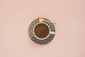 Coffee on a pastel pink background