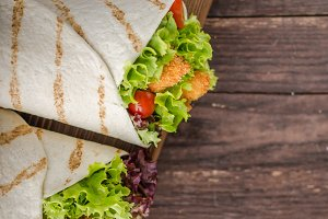 Grilled tortilla with chicken, mayo and tomato ketchuGrilled tortilla chicken, lettuce, homemade mayo and barbeque sauce