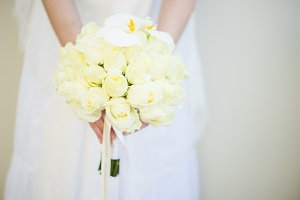 White roses in bouquet for bride