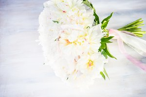 White peonies in bouquet for bride