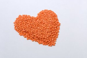 Red lentils on a white background. Healthy food