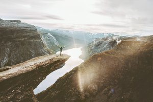 Man on Trolltunga cliff edge happy