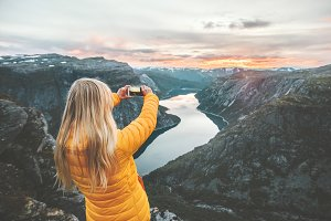 Woman taking photo by smartphone