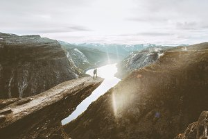 Trolltunga cliff and man traveler
