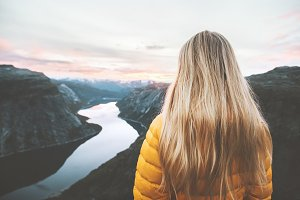 Blonde hair woman alone in mountains