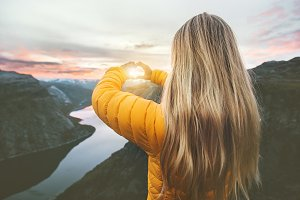 Woman traveling in sunset mountains