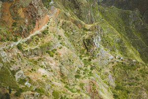 Spectacular view above sharp mountain ridge. Green valleys stretch down both sides of the ridge. Trail to Caculi Cape Verde Santo Antao