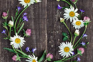 wreath of flowers on a wood backgrou