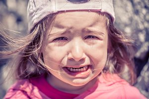 Little girl crying, tears close-up
