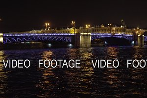 Bridge with illumination over the river at night