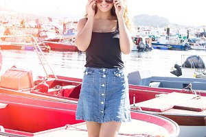 Girl on the pier of boats talking on