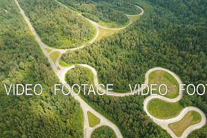 Test road in the forest. Aerial view