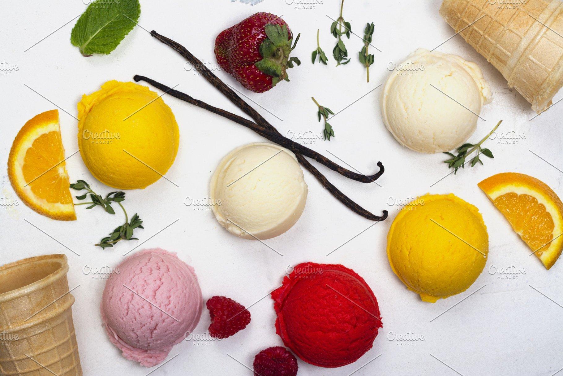 Orange Vanilla Raspberry And Strawberry Ice Cream Scoops On White Background