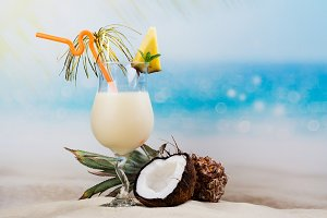 Pina colada cocktail on beach coast
