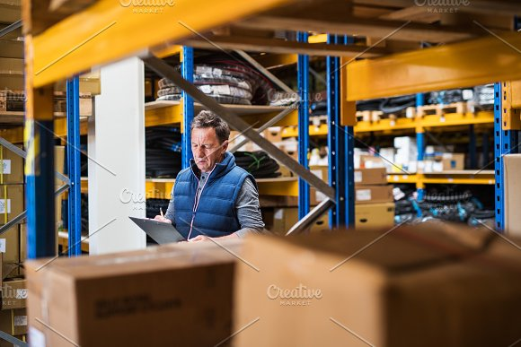 Portrait Of A Senior Male Warehouse Worker Or A Supervisor