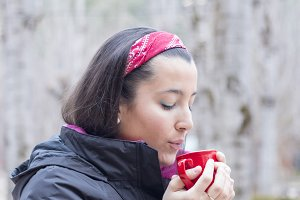 Woman driking coffee at nature