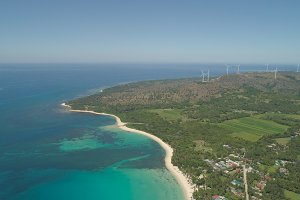 Seascape with beach and sea, windmills. Philippines, Luzon.