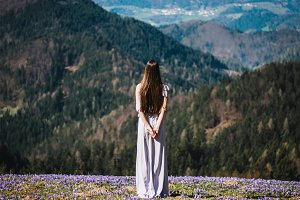 Girl standing in the flower field