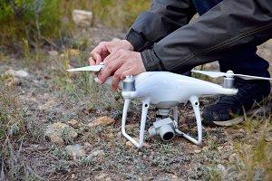drone operator installing propellers