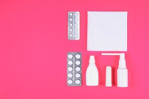Medical remedies for colds, flu on a pink pastel background. Top view. Flat lay. Copy space.
