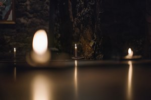 Candles lit in the dark in dark area
