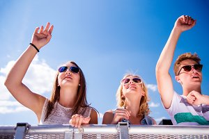 Teenagers at summer music festival having good time