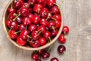 Fresh cherry on wooden background.