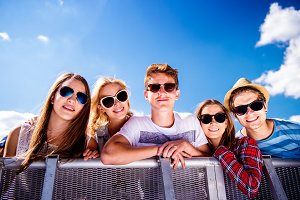 Teenagers at summer music festival, at the control barrier