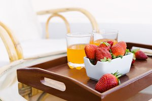 Fresh strawberry on wooden tray.